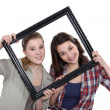 Teen behind black frame — Stock Photo #17325703