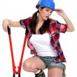 Stock Photo: Tired tradeswomholding clippers