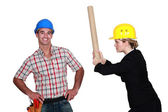 Engineer hitting a construction worker over the head — Stock Photo