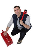 Tradesman with a pipe wrench and toolbox — Stock Photo