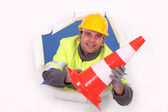 Worker holding a traffic pylon — Stock Photo