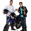 Men with motorbike and gold cup — Stock Photo