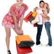 Stock Photo: Three with shopping bags