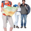 Stock Photo: Three backpackers