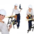 Confident woman using a workbench - Stock Photo