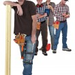 Four manual worker from different trades — Stock Photo