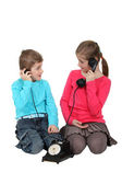 Kids using old-fashioned telephone — Stock Photo