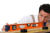 Mason measuring wood — Stock Photo