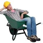 Woman asleep in wheelbarrow — Stock Photo