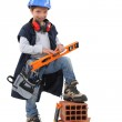 Small girl pretending to be construction worker — Stock Photo #17345095