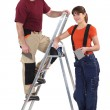 A tiler and his apprentice. — Stock Photo #17345693