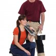 Tile cutter with female apprentice — Stock Photo #17345727
