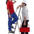 Two electricians having at chat at work — Stock Photo