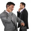 Two businessmen over the phone. — Stock Photo