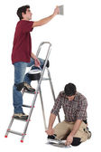 Tiler and apprentice working together — Stock Photo