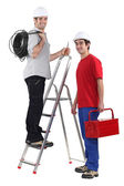 Two electrician with step ladder — Stock Photo