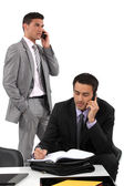 Two businessmen working towards deadline — Stock Photo