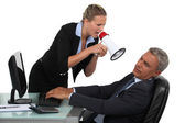 Woman with megaphone yelling at man in the office — Stock Photo