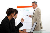 Man conducting business presentation — Stock Photo