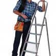 Tradesman standing next to a stepladder — Stock Photo #17350879