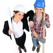 High-angle shot of tradeswomstanding next to engineer — Stock Photo #17353039