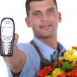 Stock Photo: Florist holding forth telephone