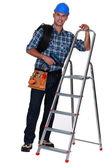 Tradesman standing next to a stepladder — Stock Photo