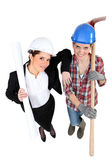 High-angle shot of a tradeswoman standing next to an engineer — Stock Photo
