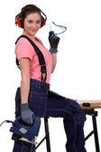 žena s pásová pila — Stock fotografie