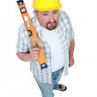 High angle shot of carpenter with ruler — Stock Photo