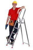 Man with ladder stood by step-ladder — Stock Photo