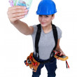 Electrician with a handful of cash — Stock Photo #17381751
