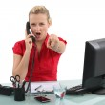 Secretary to the angry phone — Stock Photo #17386265