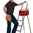 Stock Photo: Worker with toolbox and stepladder