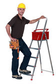 Worker with a toolbox and stepladder — Stock Photo