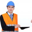 Young architect holding board — Stock Photo