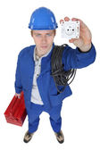 Electrician stood with socket and tool box — Stock Photo