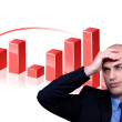 Stressed businessman standing by bar chart — Stock Photo #17401747