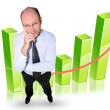 Man stood by graph - Stock Photo
