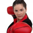 Woman throwing a punch — Stock Photo #17403125