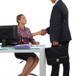 Businessman shaking hands with his new secretary — Stock Photo