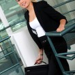 Stock Photo: Businesswomwith briefcase climbing steps