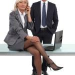 Smart businessman and businesswoman, studio shot — Stock Photo #17409029