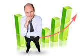 Man stood by graph — Stock Photo