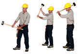 Three identical men hold sledge-hammers — Stock Photo