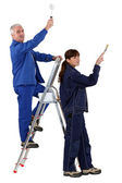 Man and woman redecorating — Stock Photo