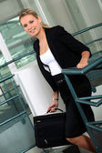 Businesswoman with briefcase climbing steps — Stock Photo