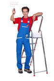 Decorator with a paint roller and stepladder — Stock Photo