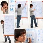 Boy writing on a whiteboard — Stock Photo