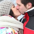 Stock Photo: Couple kissing during winter holiday